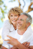 Mature couple smiling — Stock Photo
