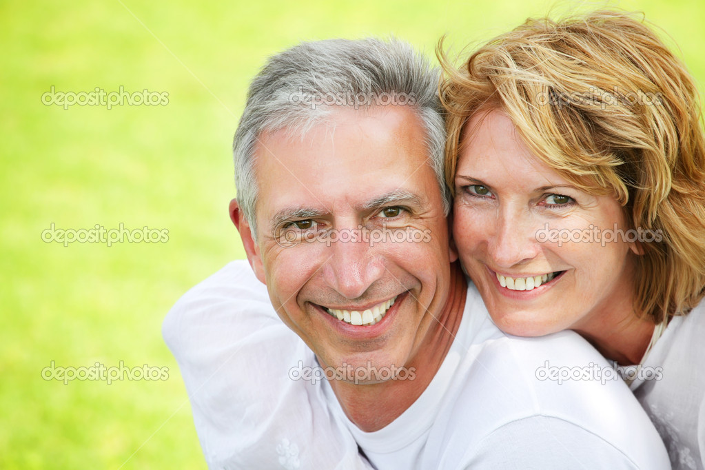 Close-up portrait of a happy mature couple smiling and embracing.  — Photo #8730329