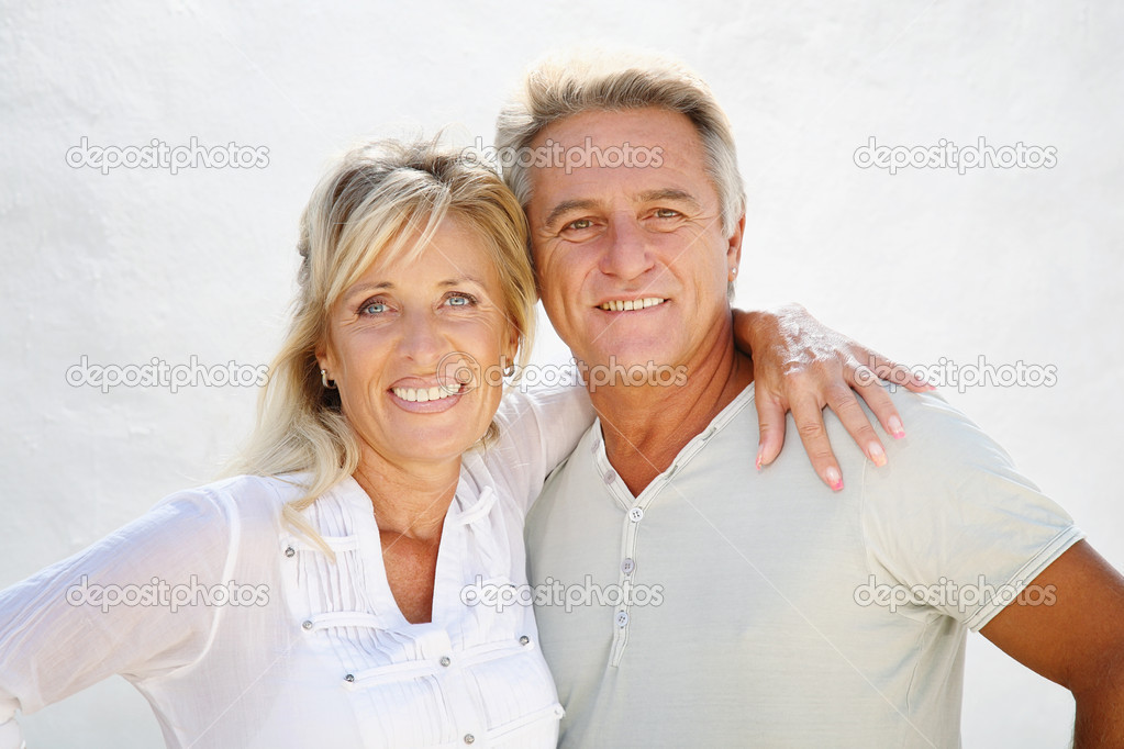 Closeup portrait of a happy mature couple smiling and embracing.  — Stock Photo #8731611