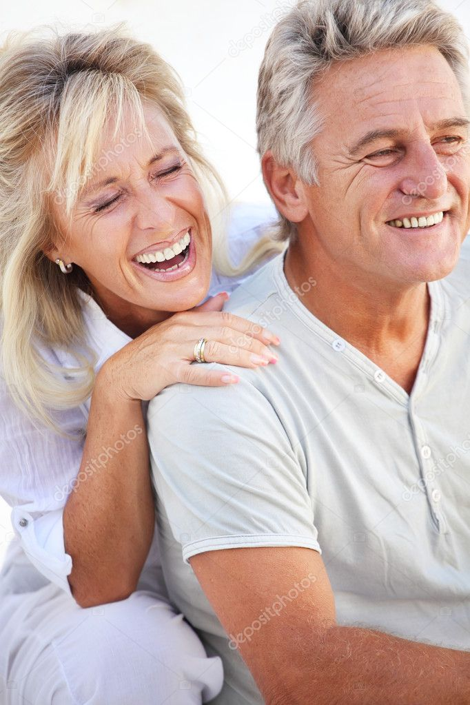 Closeup portrait of a happy mature couple laughing.  — Stock Photo #8731694