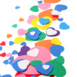 Colorfull foam confetti hearts — Stock Photo