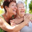 Stock Photo: Beautiful senior mother and daughter