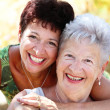 Beautiful senior mother and daughter - Stock Photo