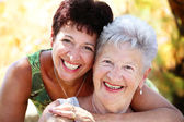 Beautiful senior mother and daughter — Stock Photo