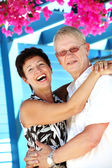 Happy mature couple smiling and embracing — Stock Photo