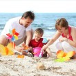 Happy family on the beach. — Stock Photo