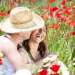 Happy young couple enjoying themselves on a meadow — Stock Photo