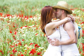Happy young couple on a meadow — Stock Photo