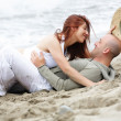 Young romantic couple having fun on the beach — Stock Photo