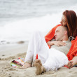 Young romantic couple relaxing on the beach — Stock Photo
