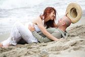 Young romantic couple having fun on the beach — Stock Photo