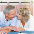 Happy mature couple at home — Stock Photo