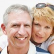 Stock fotografie: Mature couple smiling and embracing.