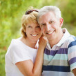 Mature couple smiling and embracing. — Stock Photo