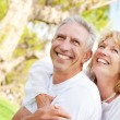 Happy mature couple outdoors — Stock Photo #9245768