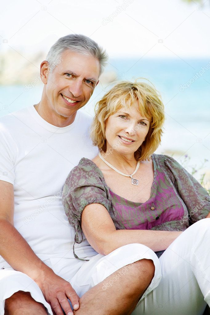 Portrait of a happy mature couple outdoors.  Stock Photo #9245832