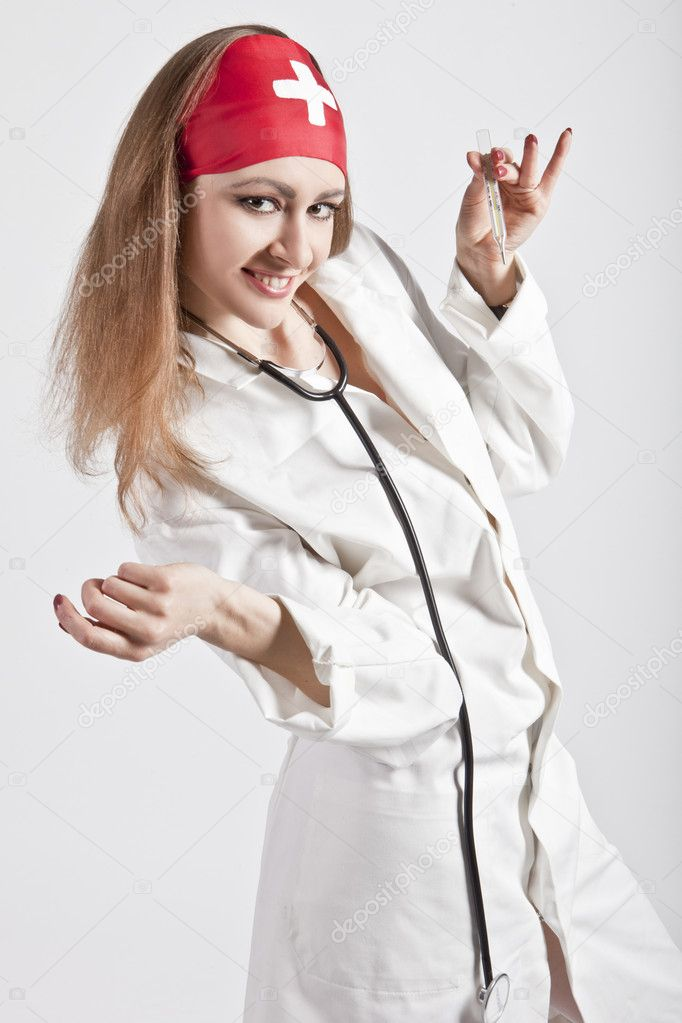 Beautiful nurse with a thermometer, and smiles phonendoscope — Stock Photo #9994562