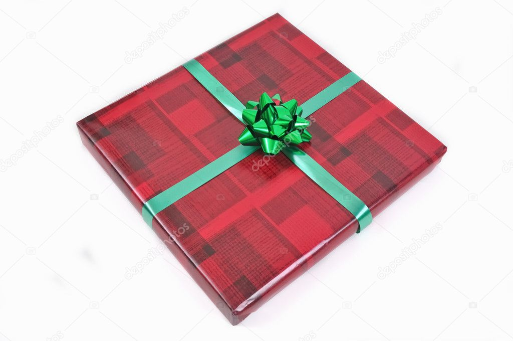 Gift in wrapping paper and bow — Stock Photo #8862756