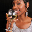 African American woman enjoying wine — Stock Photo