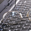 Keyboard and glasses — Stock Photo