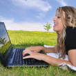 Young lady with computer — Stock Photo