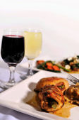 Italian chicken dinner with wine — Stock Photo
