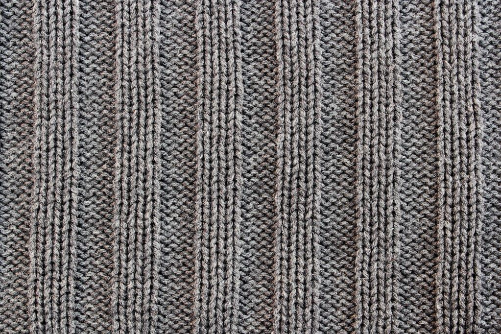Crocheted texture from a sweater made of wool — Stock Photo #9887120