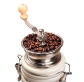 Ceramic coffee-grinder full of arabica — Stock Photo