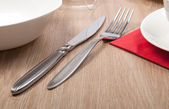 Fork and knife on a table — Stock Photo