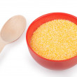 Hominy grits in plate isolated on a white — Stock Photo