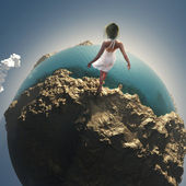 Woman on globe — Stock Photo
