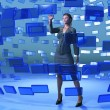 Businesswoman touching blue screen — Stock Photo