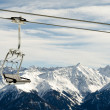 Chairlift before mountain panorama — Stock Photo