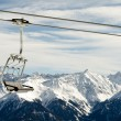 Chairlift before mountain panorama — Stock Photo #10010985