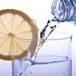 Stock Photo: Pour glass of water with lemon