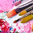 Color palette with many brushes - Stock Photo