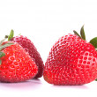 Three red strawberries — Stock fotografie
