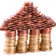 A house build of coins — Stock Photo