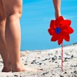 Red wind turbine on the beach — Stock Photo