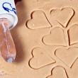 Stock Photo: Rolling pin with many gouged heart ramekins