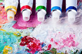 Color palette with different color tubes — Stock Photo