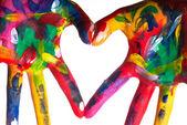Dwa kolorowe ręce tworząc v1 serca — Zdjęcie stockowe