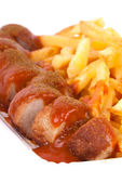 Curried sausage and chips — Photo