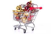 Shopping cart with Christmas balls — Stock Photo