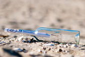 Message in a bottle in the sand — Stock Photo