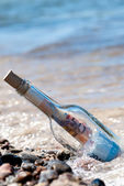 Message in a bottle euronotes — Stock Photo
