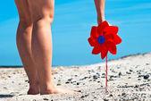 Red wind turbine on the beach — Stock Photo