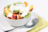 Bowl of fresh fruit and yogurt V1 — Stockfoto