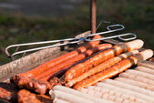 Many sausages on the grill — Stock Photo