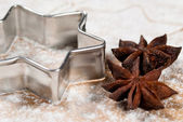 Star-shaped and star anise in the flour V2 — Стоковое фото